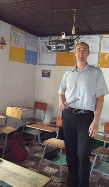 Trevor posing with one of the IW2s after he finished installing it in the third classroom