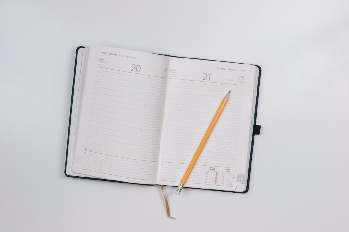 Schedule/planner open with a pencil on it