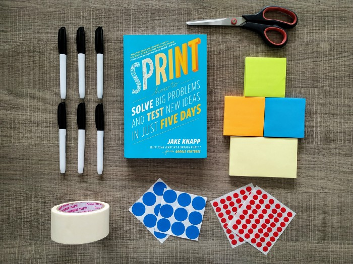 A Sprint book orderly surrounded by workshop materials on a wooden platform