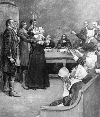 Salem witch trials: accused witches look fearful as their accusers frantically point and cry