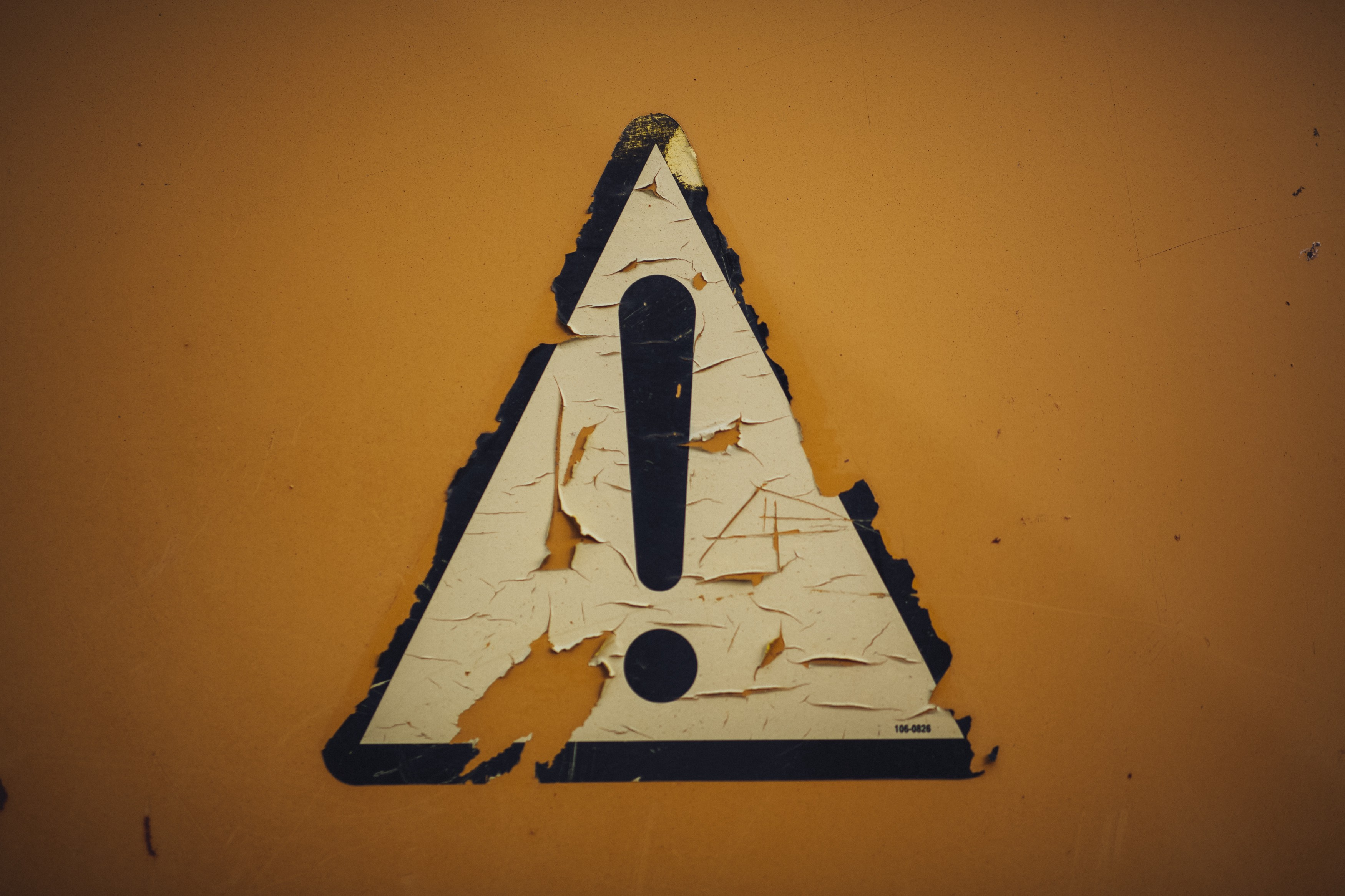 A tattered caution sign
