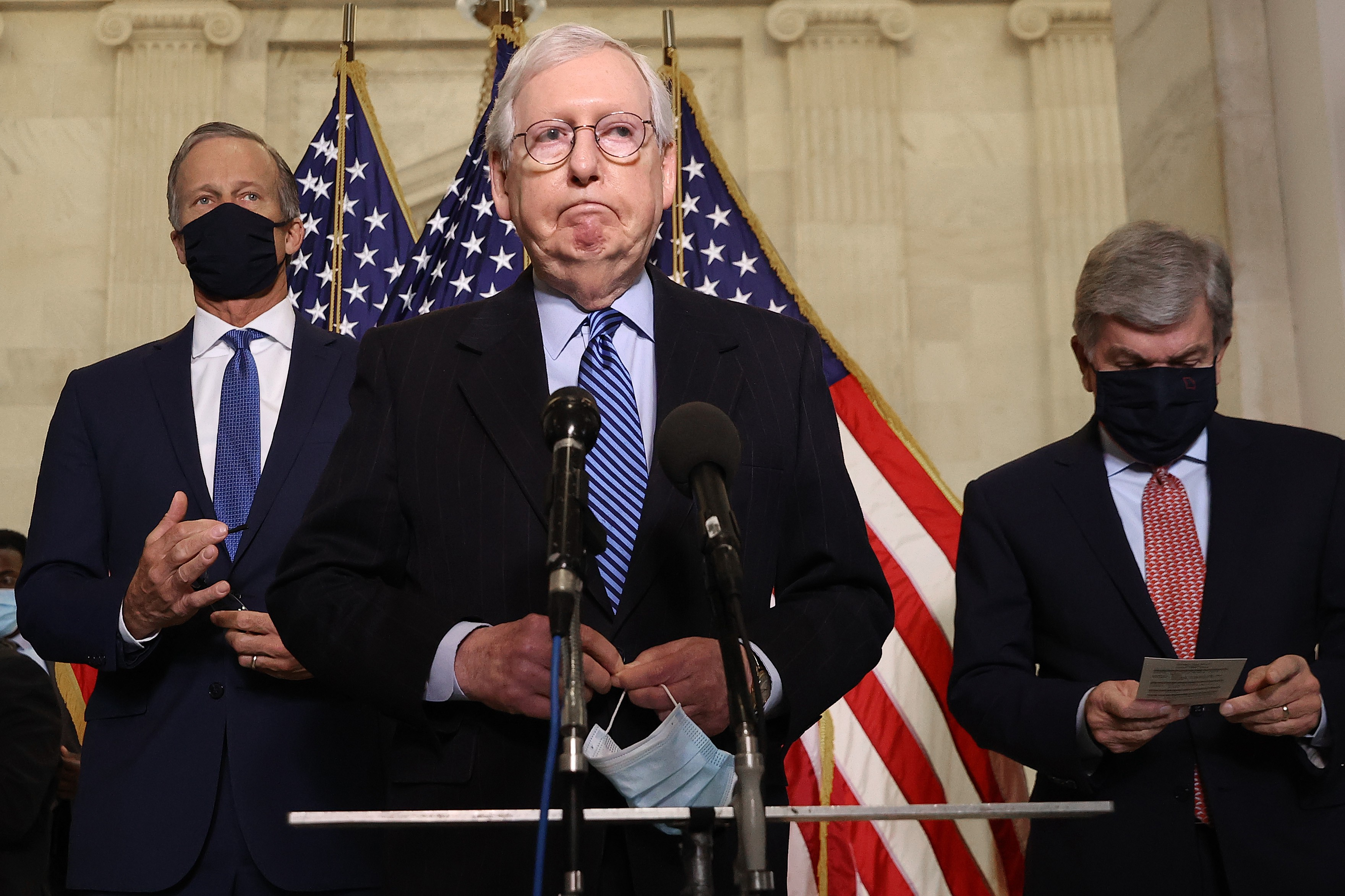 Mitch McConnell speaking into a mic.