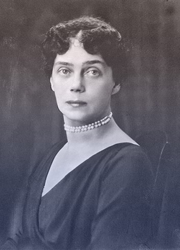 Grand Duchess Xenia wearing a black v-neck dress and a double-stranded pearl choker.