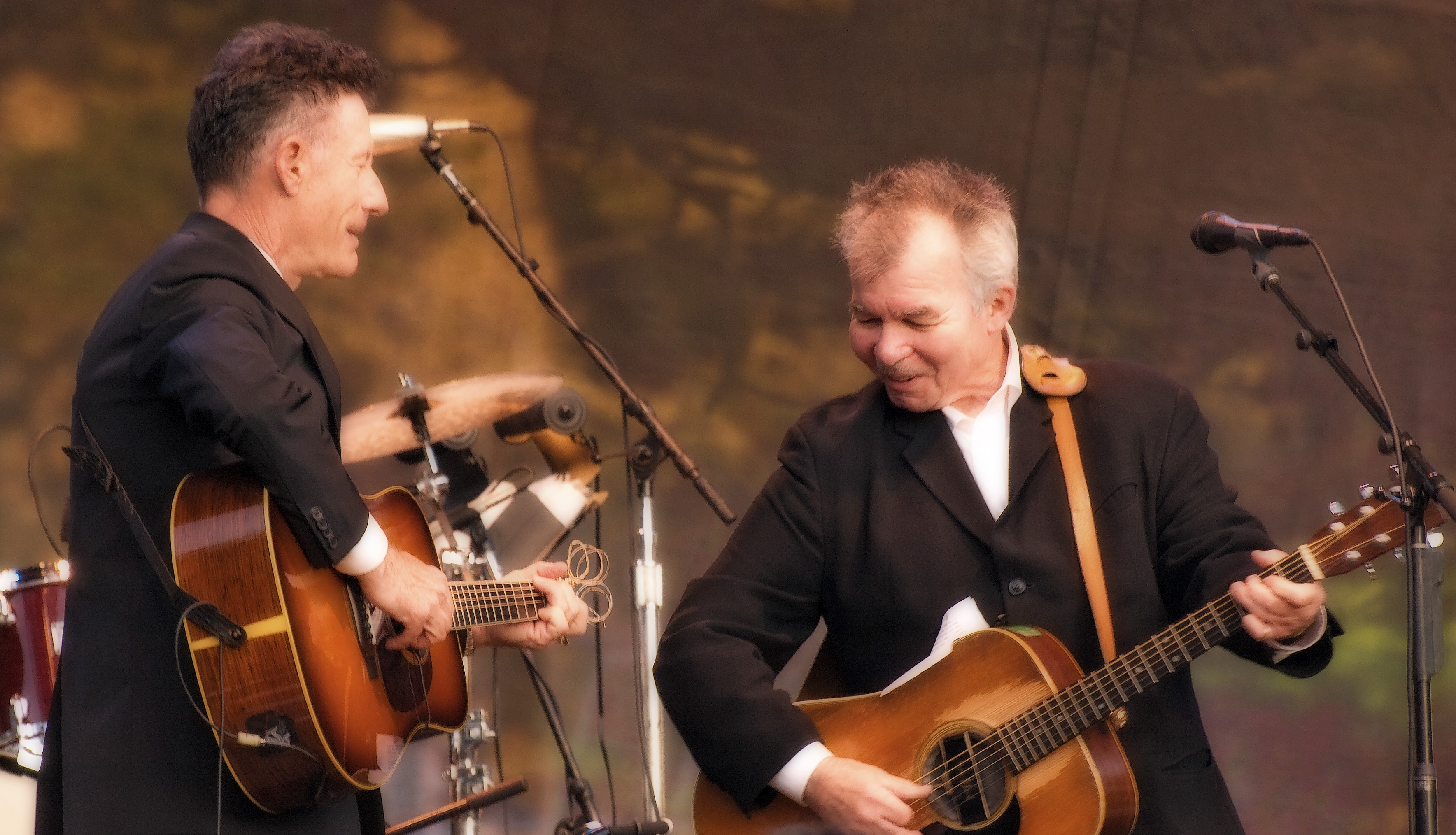 Photograph of John Prine and Lyle Lovett in concert.