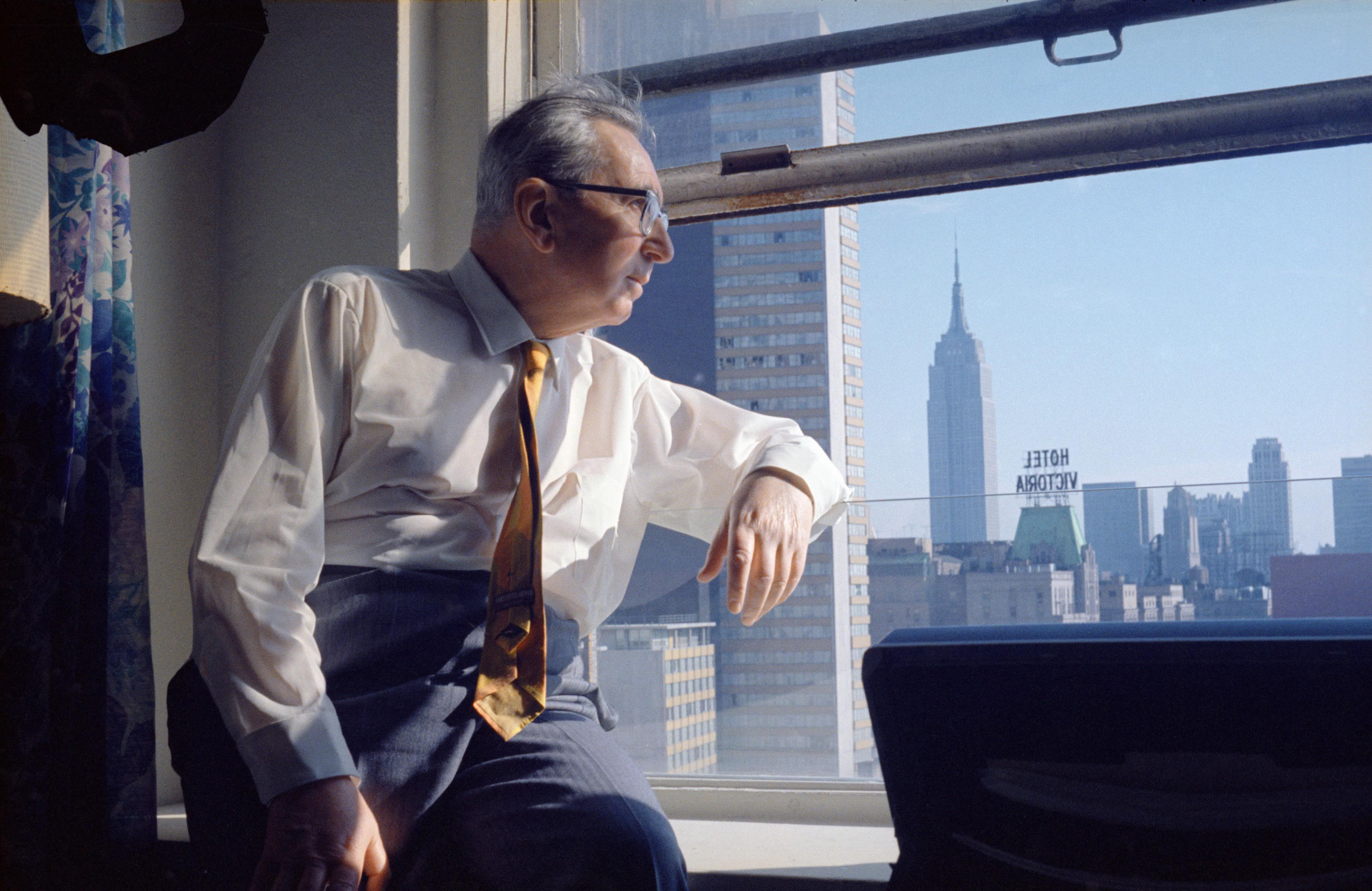 An archival photo of Viktor Frankl in New York City looking out the window, 1968.