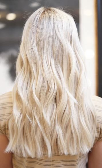 Get a head start on summer by choosing a yellow-blonde hairstyle like this one