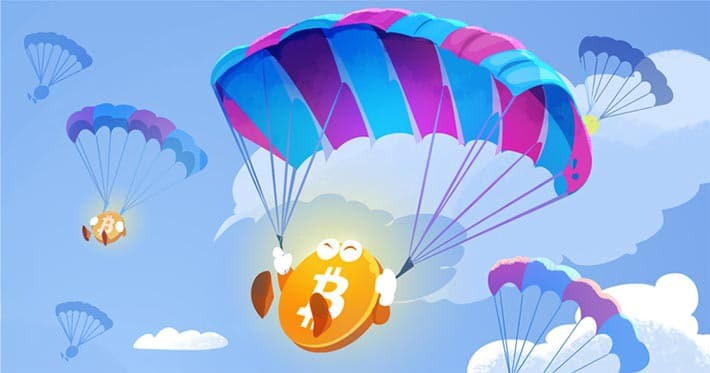 illustration d'un airdrop de Bitcoin ou de cryptomonnaies