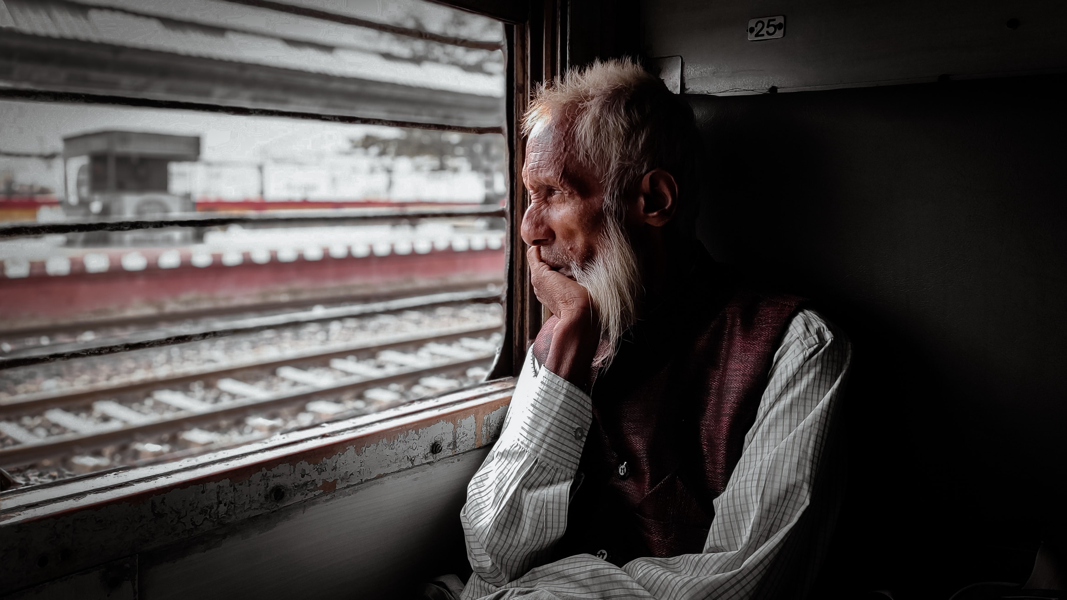 Old retired man riding a train