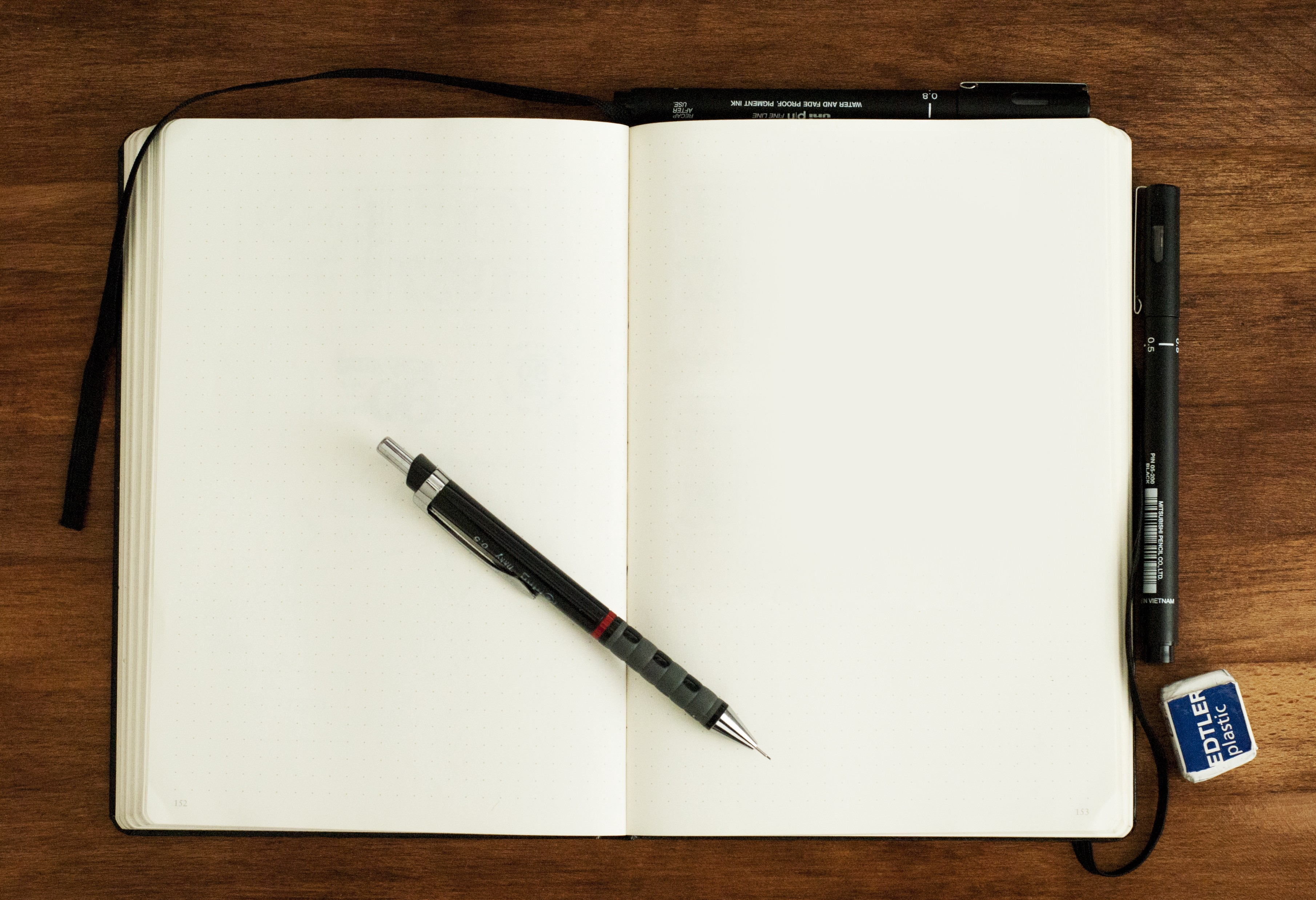 black and silver retractable pen on blank book—8 writing ideas for when you run out of ideas