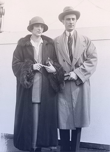 Felix and Irina in traveling clothes—coats, hats, and gloves.