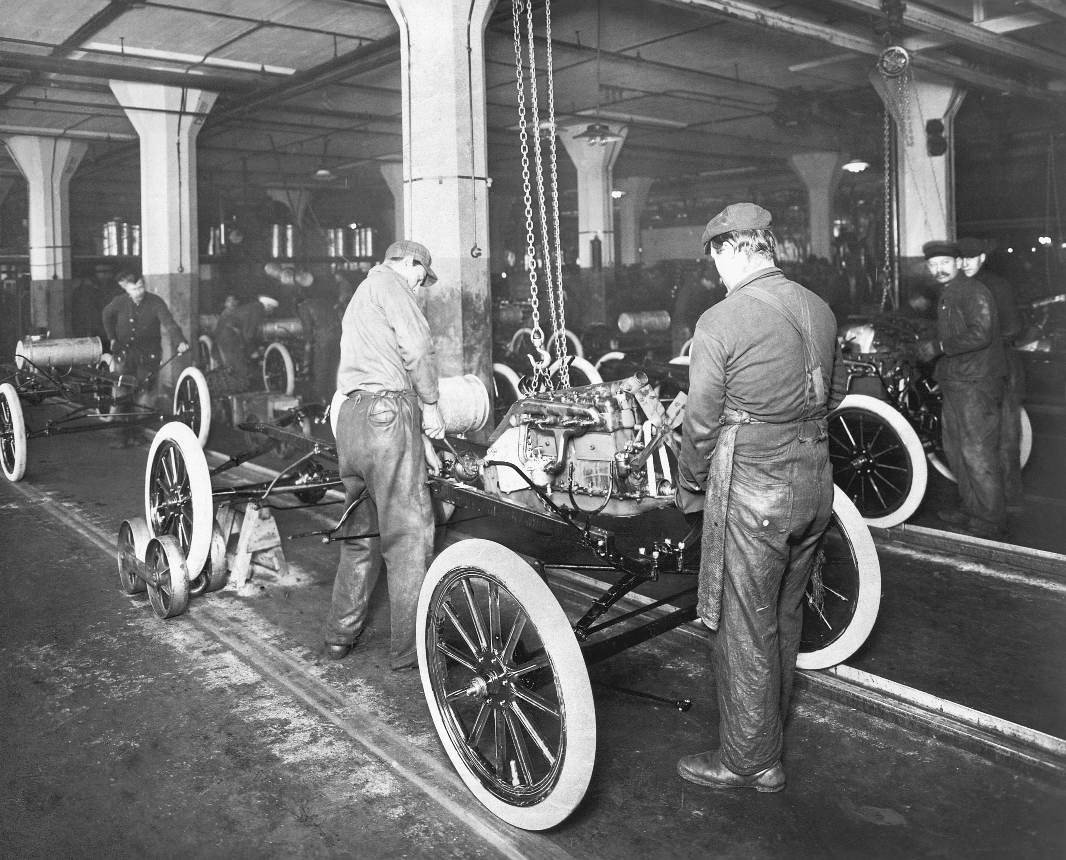 Factory workers on the Model T assembly line at Ford circa 1913.