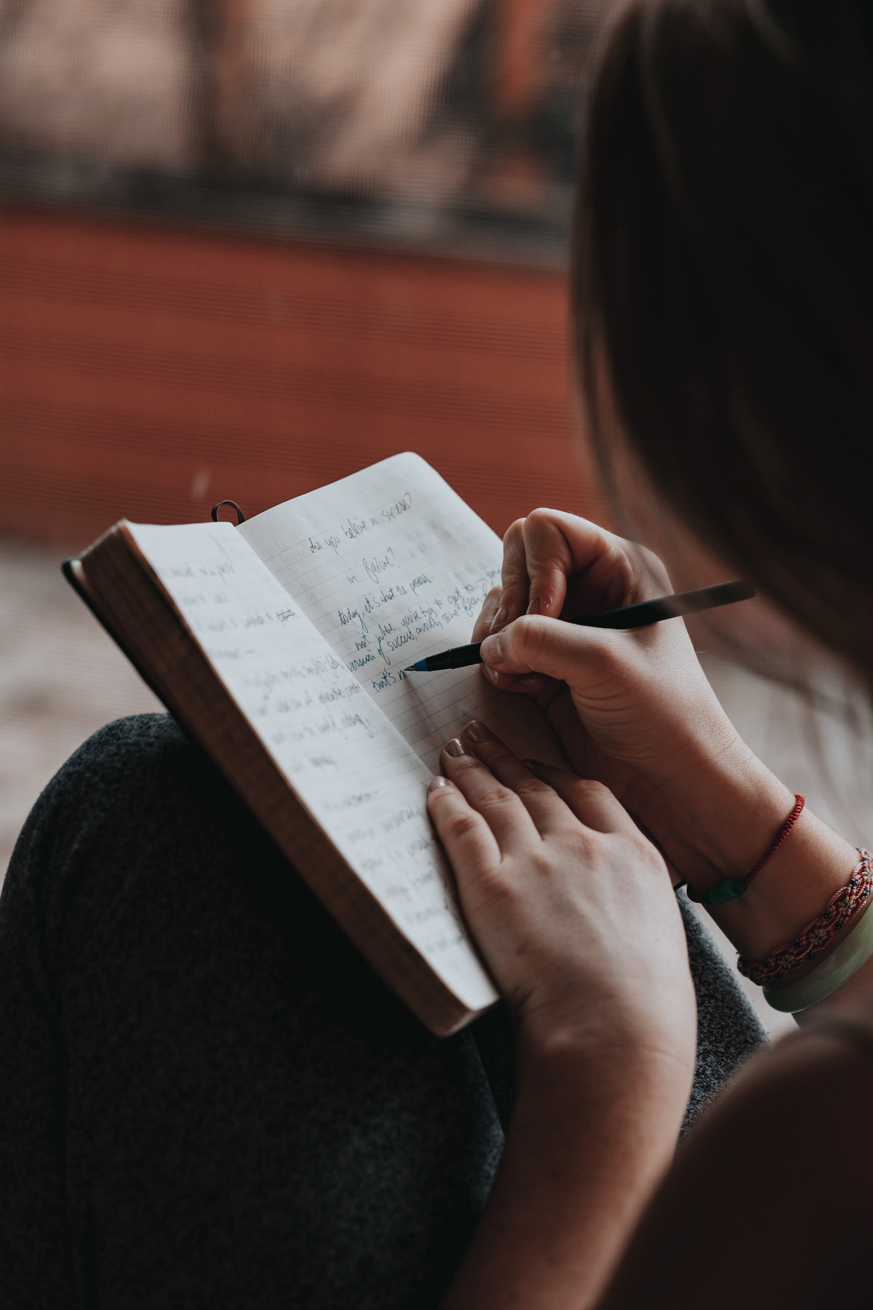 Professional writer writing in their notebook with a pen