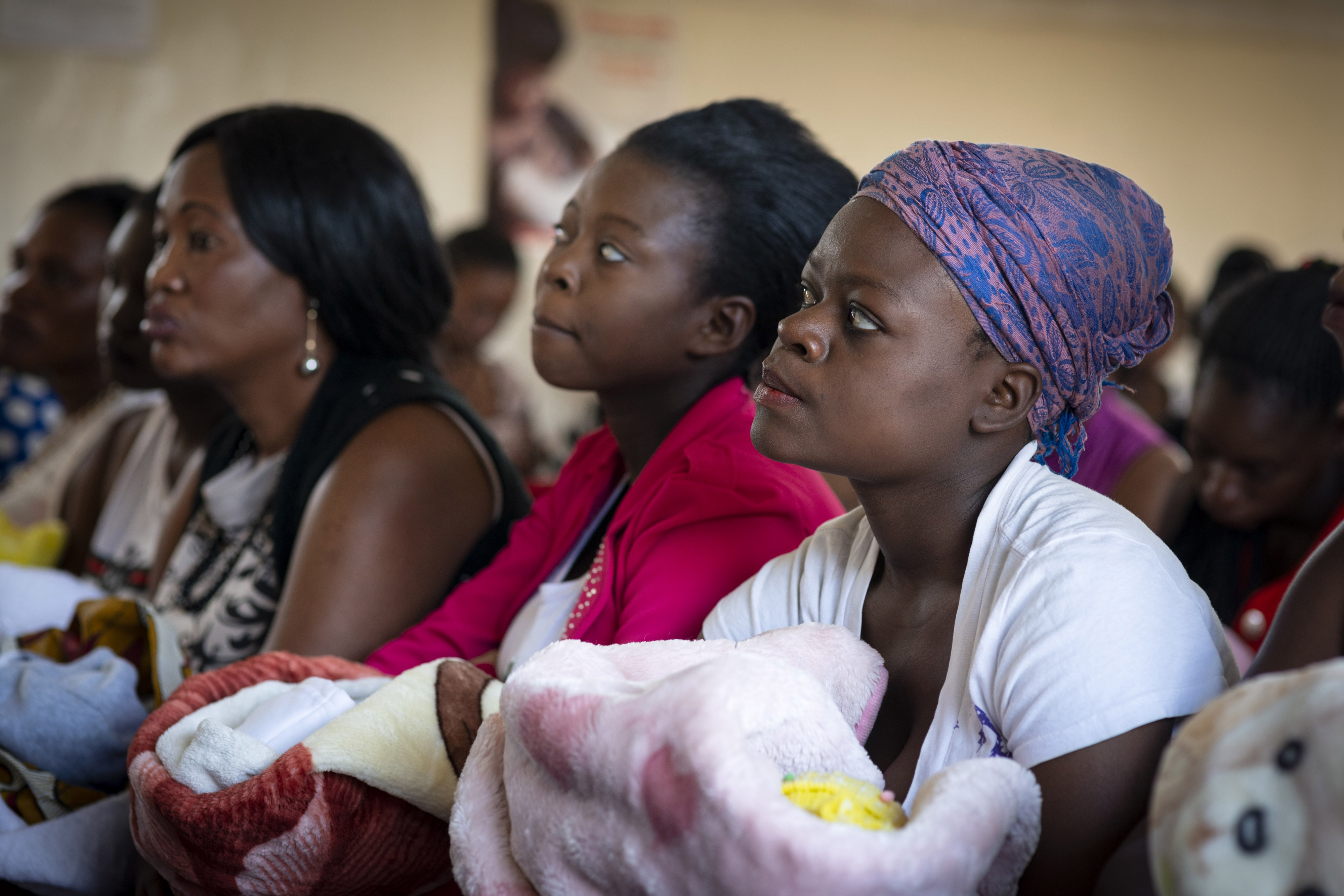 Group of women holding babes in arms. Image credit: Safe Motherhood Alliance