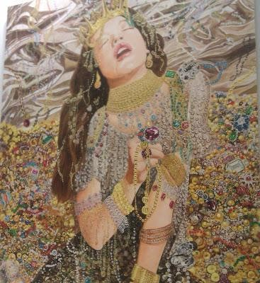 A painting of a woman kneeling in mounds of precious jewels, crowned and jeweled herself head-to-toe in all sorts of precious gold and jewels. Her long brown hair is leaning back like her head and closed eyes, mouth agape with drool, as she is grasping jewels in her hand as if she is ecstasy from it.