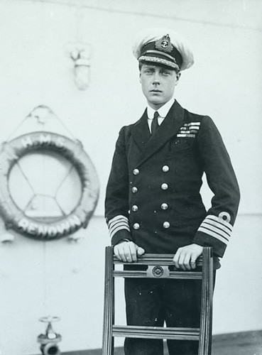 Edward in his naval uniform, posing on the deck of the HMS Renown.