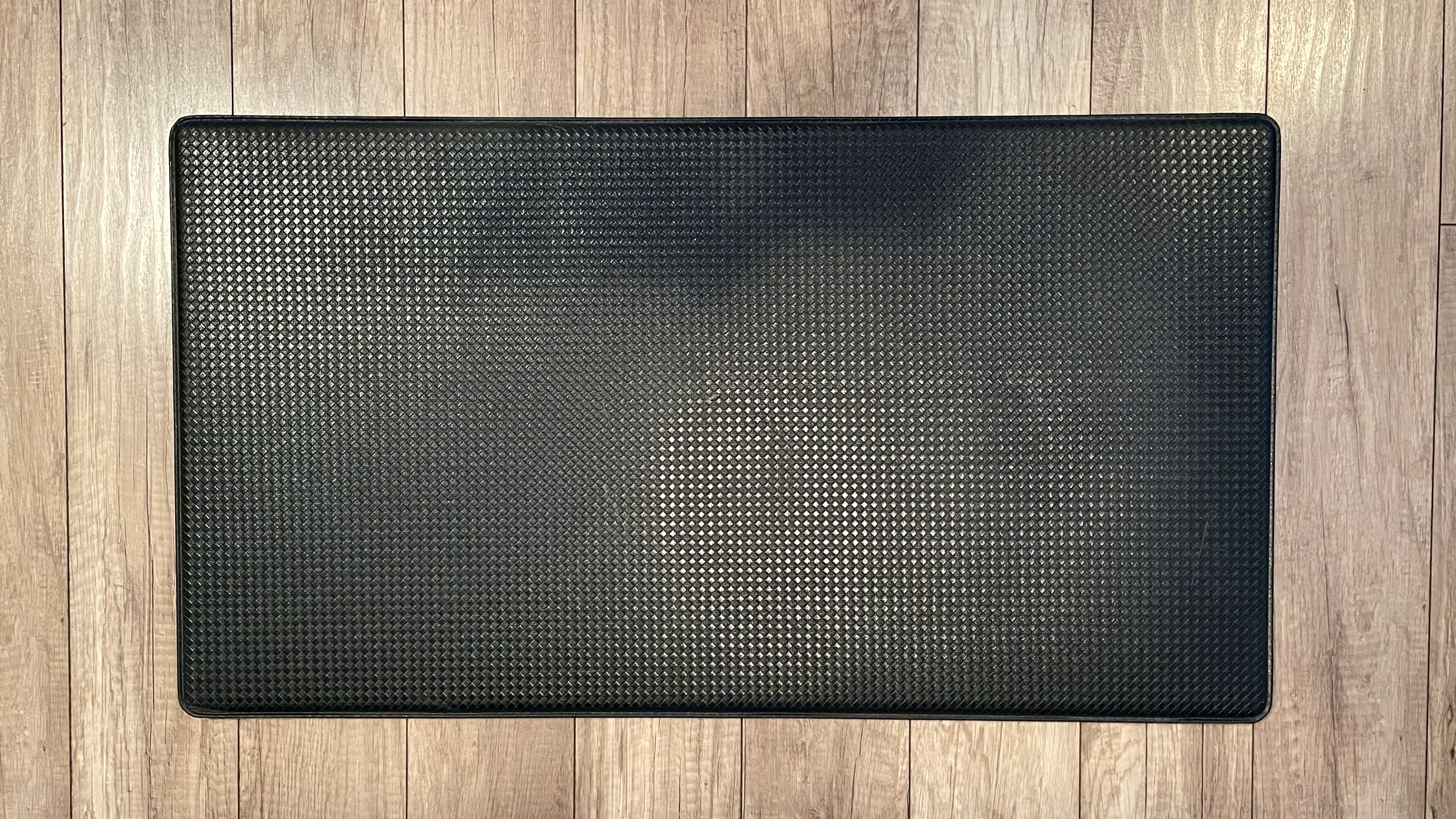 Black Desk Mat that I use while standing on wood floor.