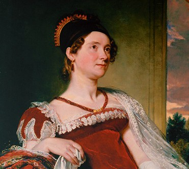 Louisa Adams in a red empire-waist gown with a black cap over her brown curls.