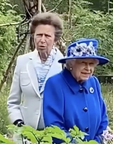 Queen looks radiant in vibrant coat and matching hat as she joins Princess Anne in Scotland