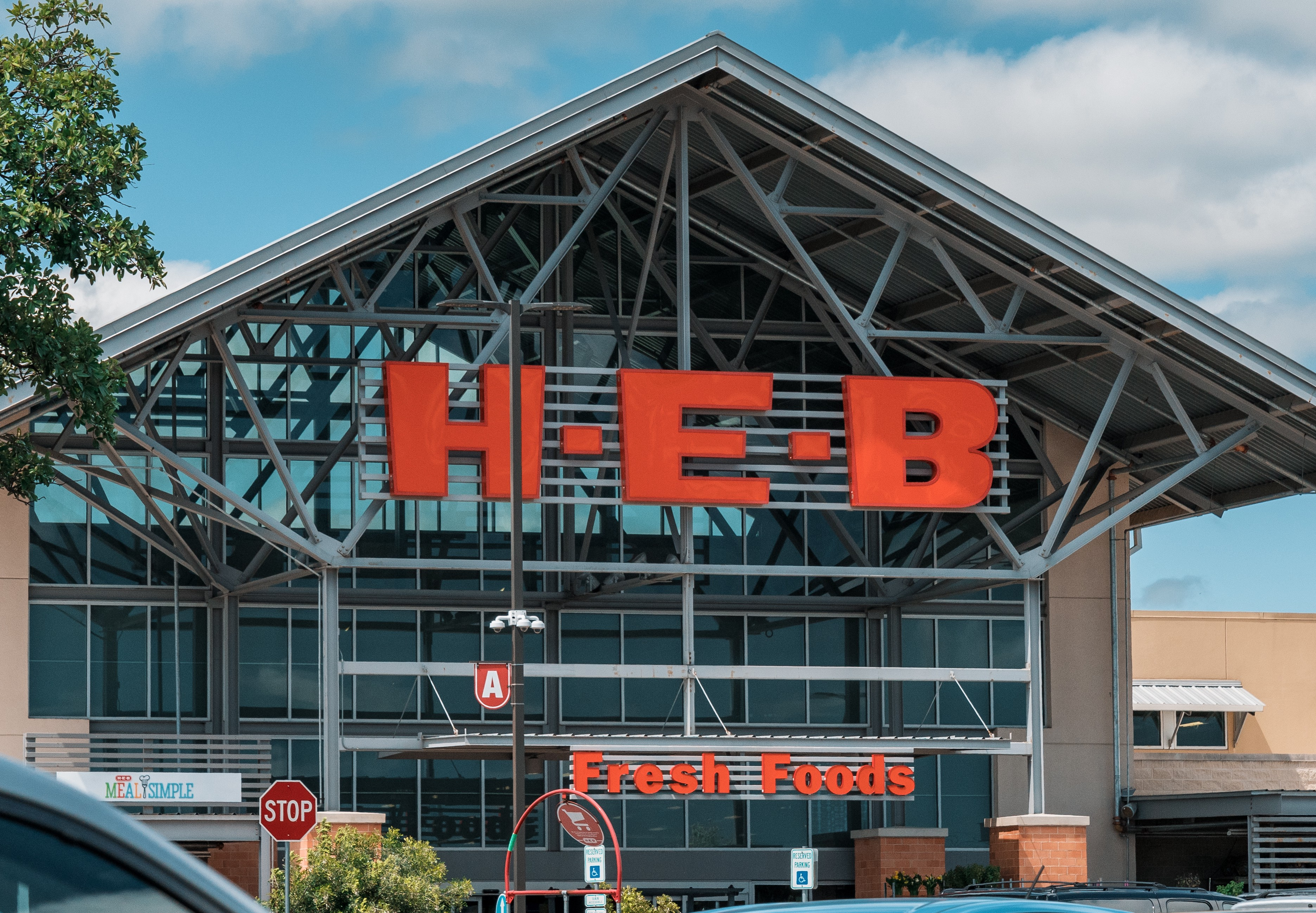 H-E-B Grocery Store and parker cars in front, Texas