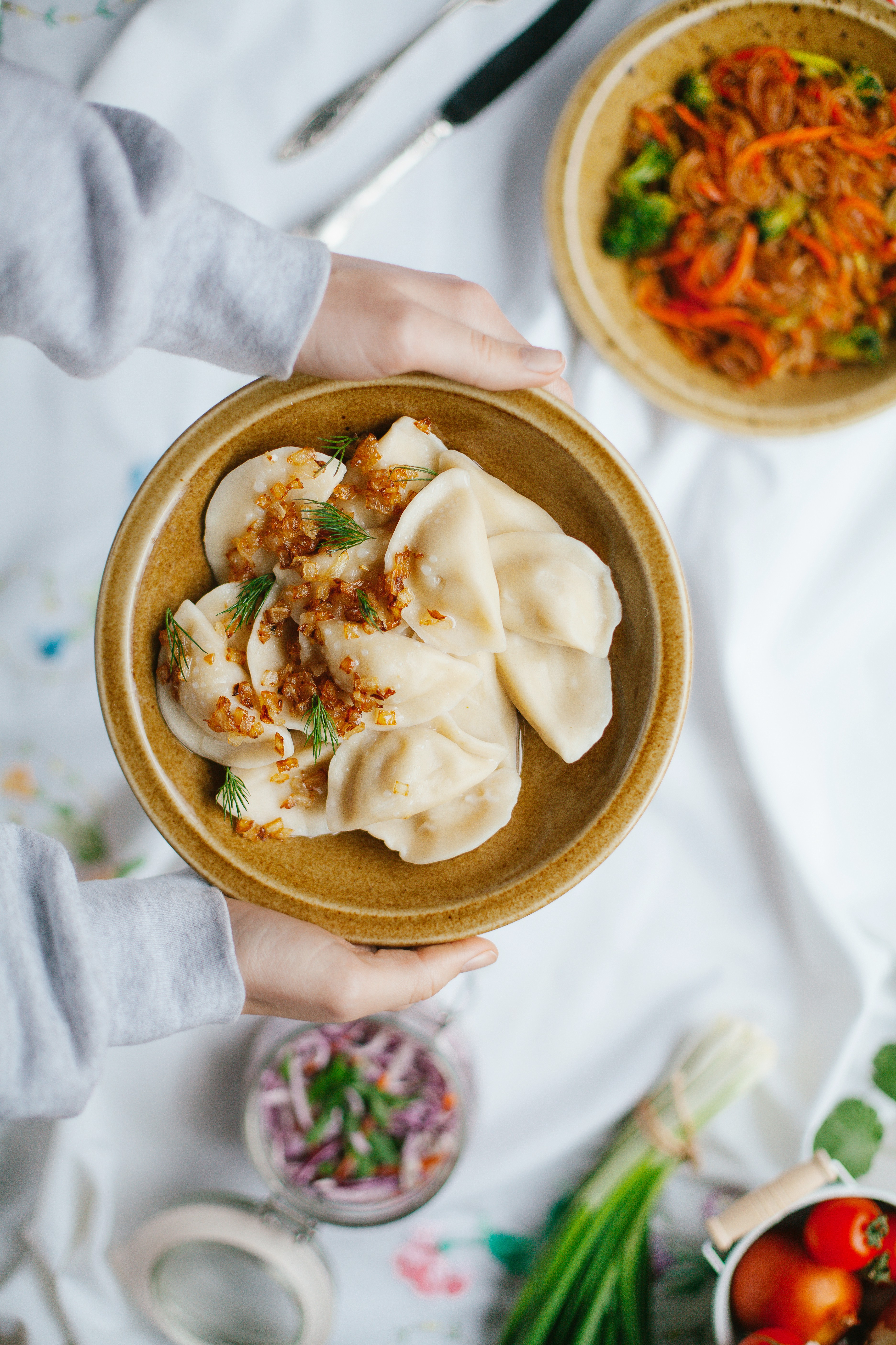 Dumplings on a plate which tragically haven't been fried yet