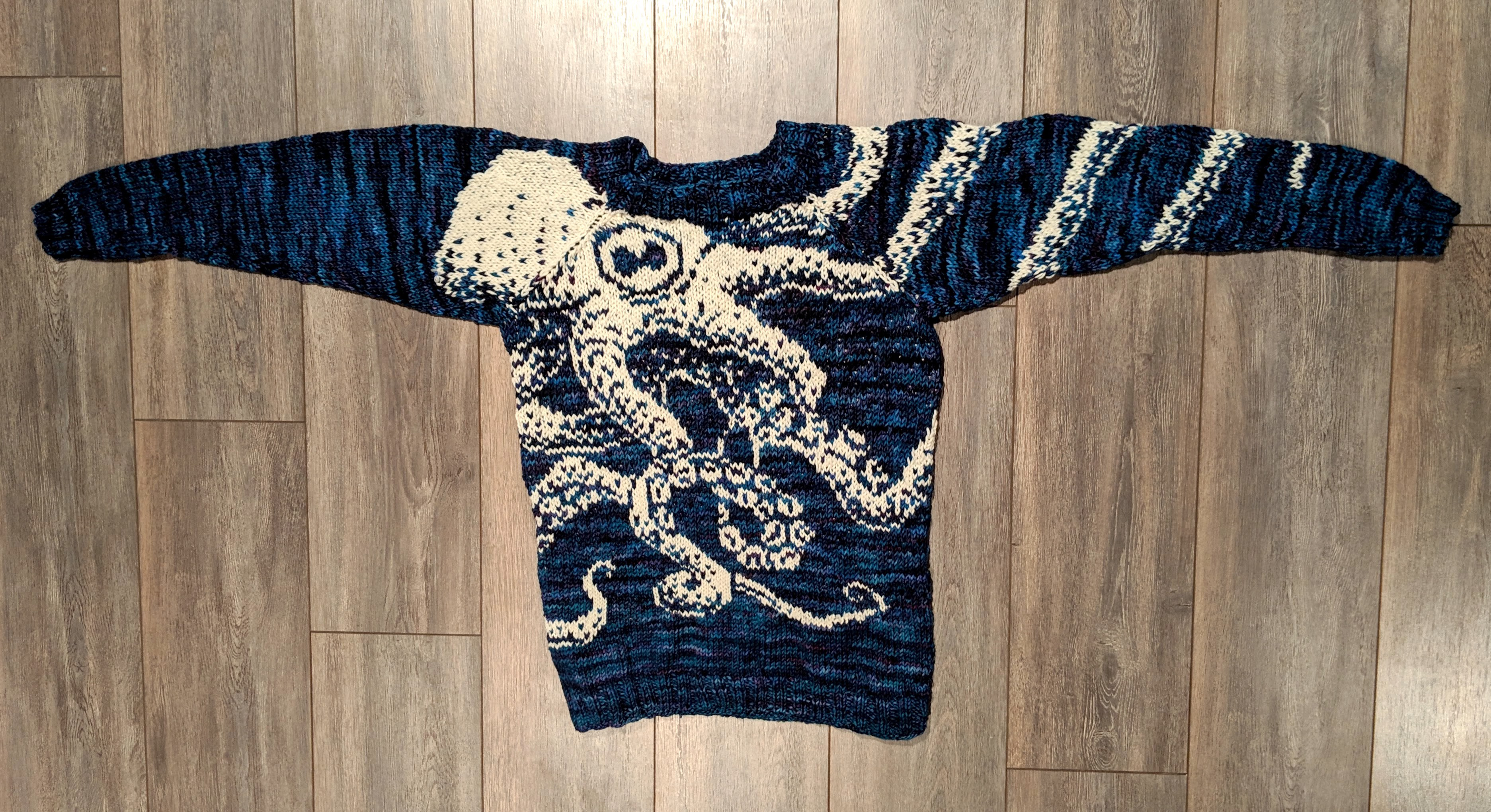 a knit octopus sweater in blue and white