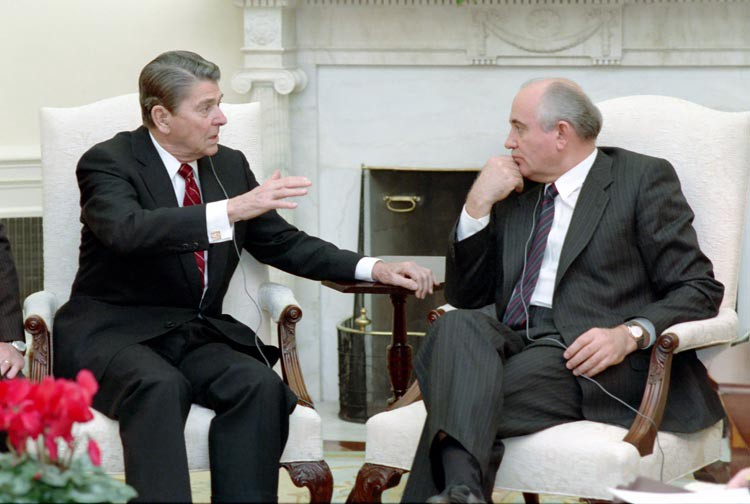 Ronald Reagan and Mikhail Gorbachev speak in the White House.