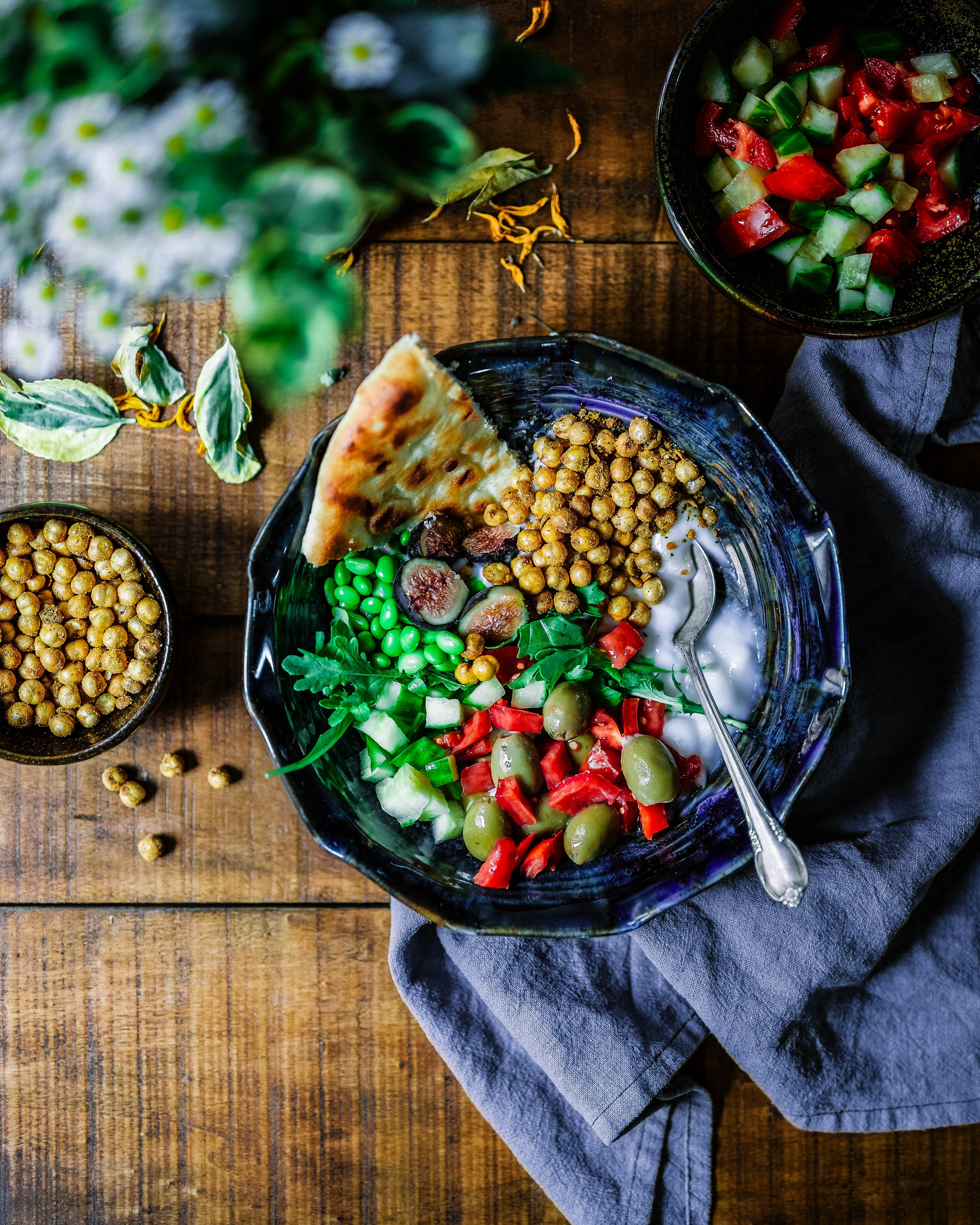 platter of vegetables and chickpeas with flatbread