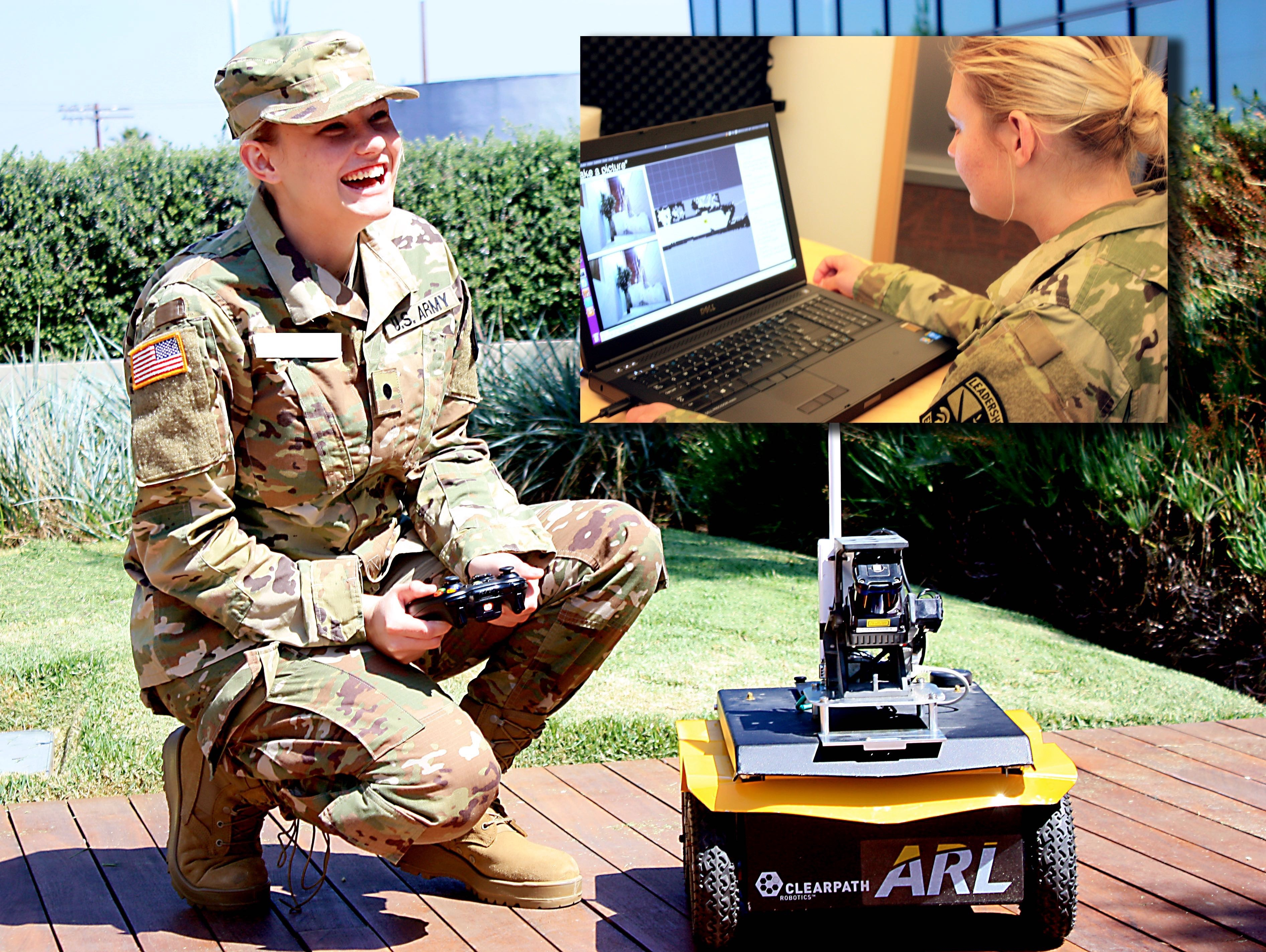 A U.S. Army engineer crouched next to a robotic car, holding its controls.