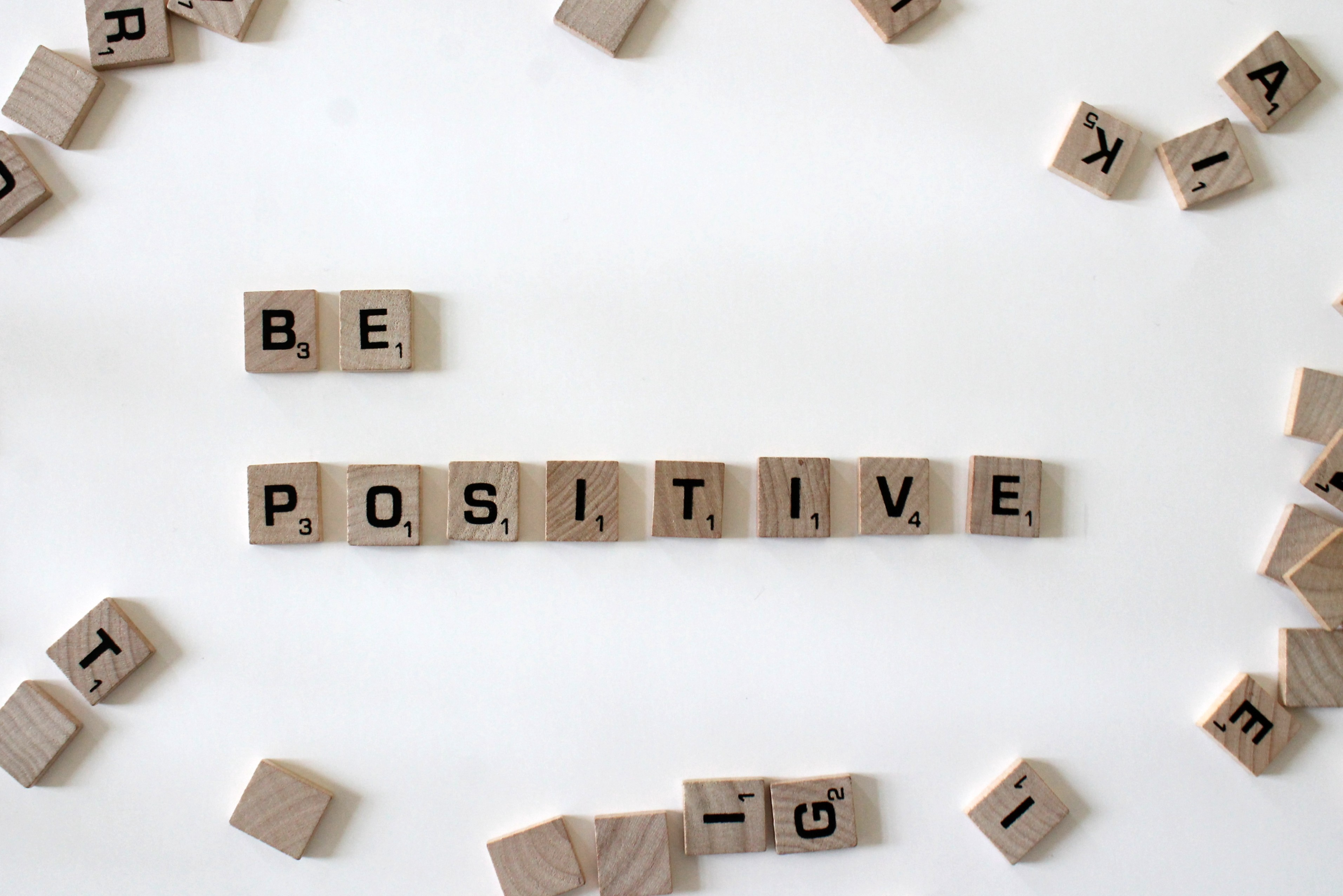 """Scrabble tiles spelling out the words """"Be positive"""""""