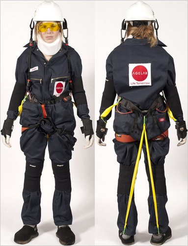 back and front photos of person in age simulation suit — gloves, helmet and lots of straps to inhibit movement
