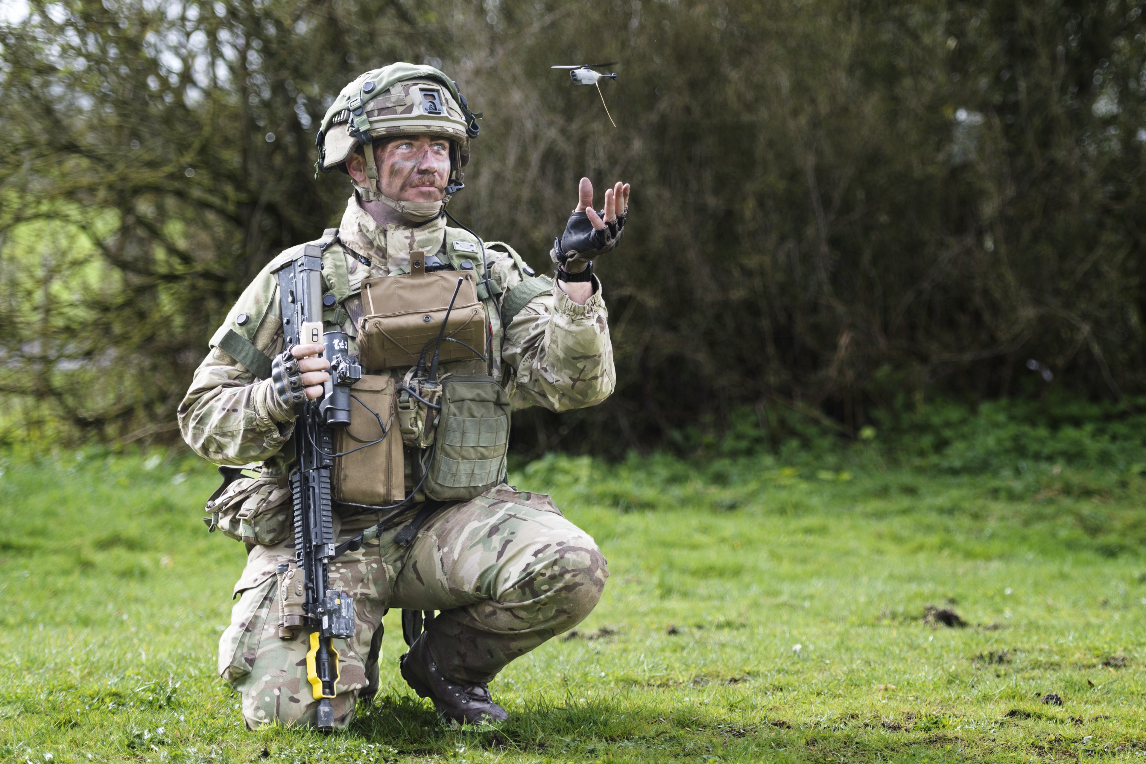 Soldier handling a small remote piloted piece of technology