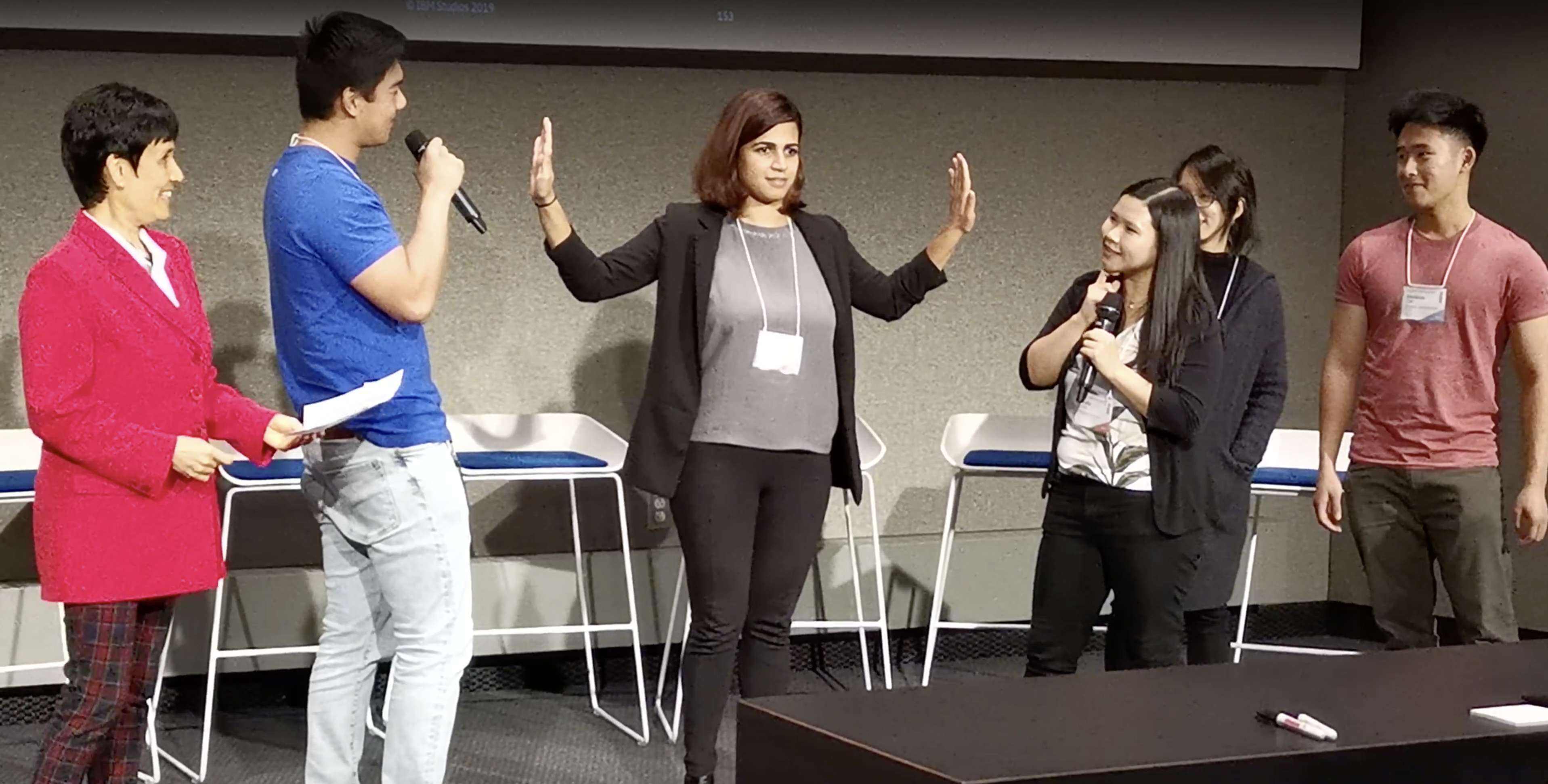 This is an image of our team presenting our final story on stage as a skit to the rest of the conference.