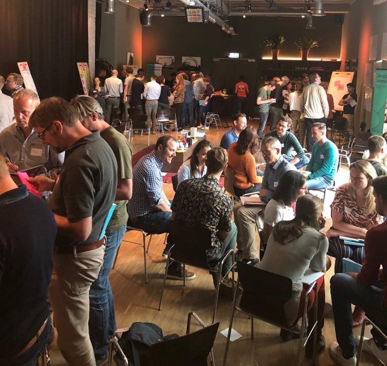A crowded Gallery Walk during the Liberating Structures Immersion Workshop in Amsterdam, May 2019.