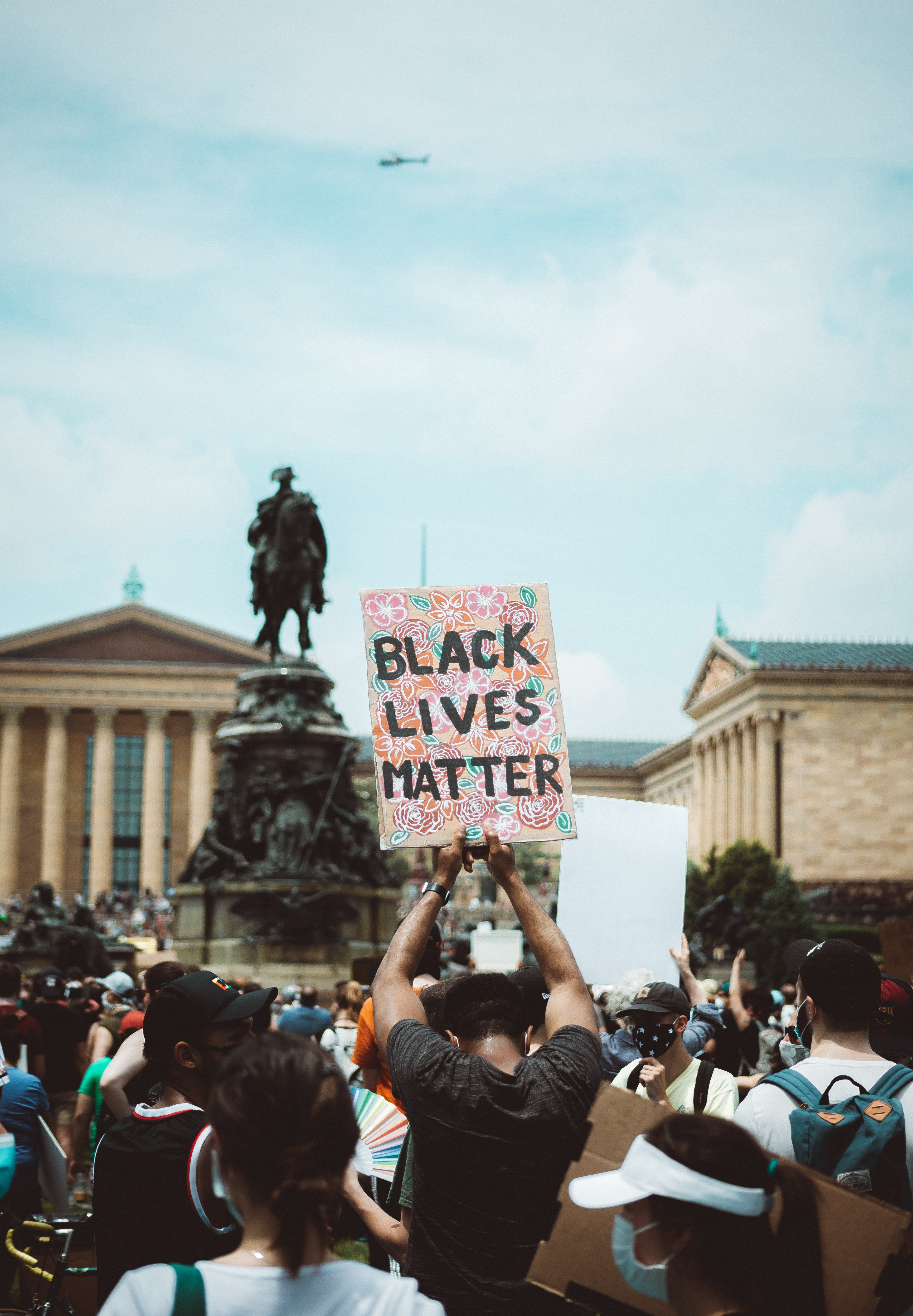 Black Lives Matter protesters at the foot of a Confederate Statue