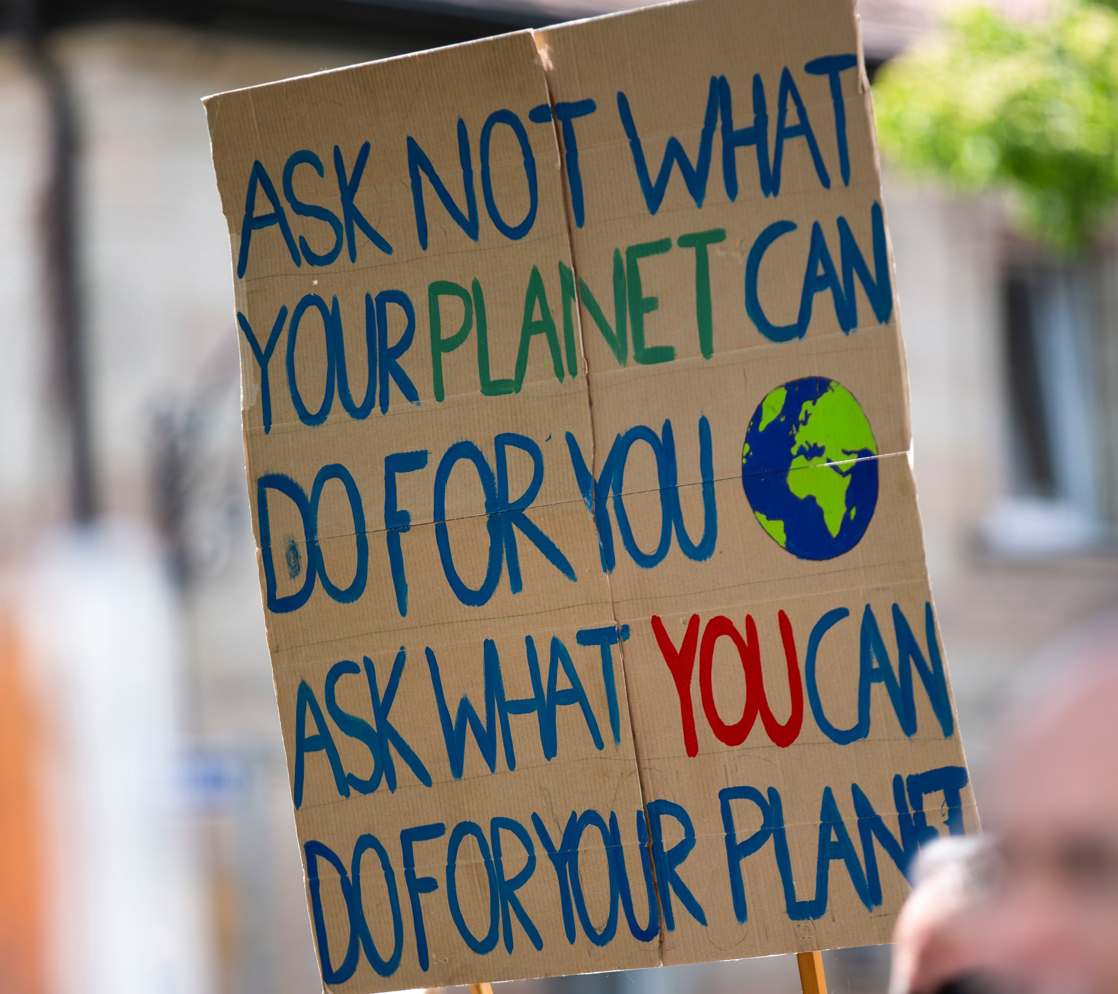 motivational quote about environment friendly business and action on cardboard