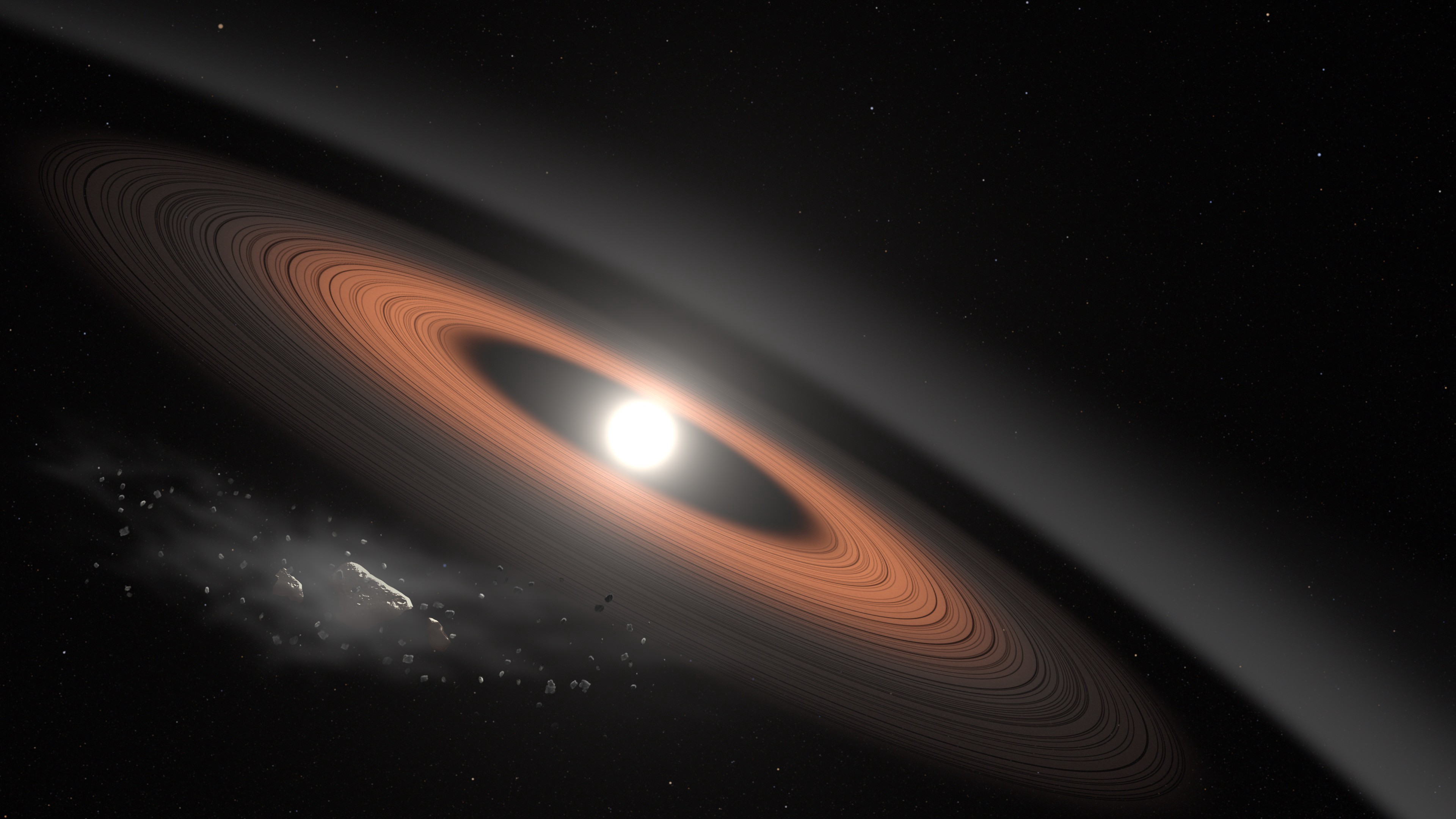 Rings surround a small, bright star with debris in the bottom left.