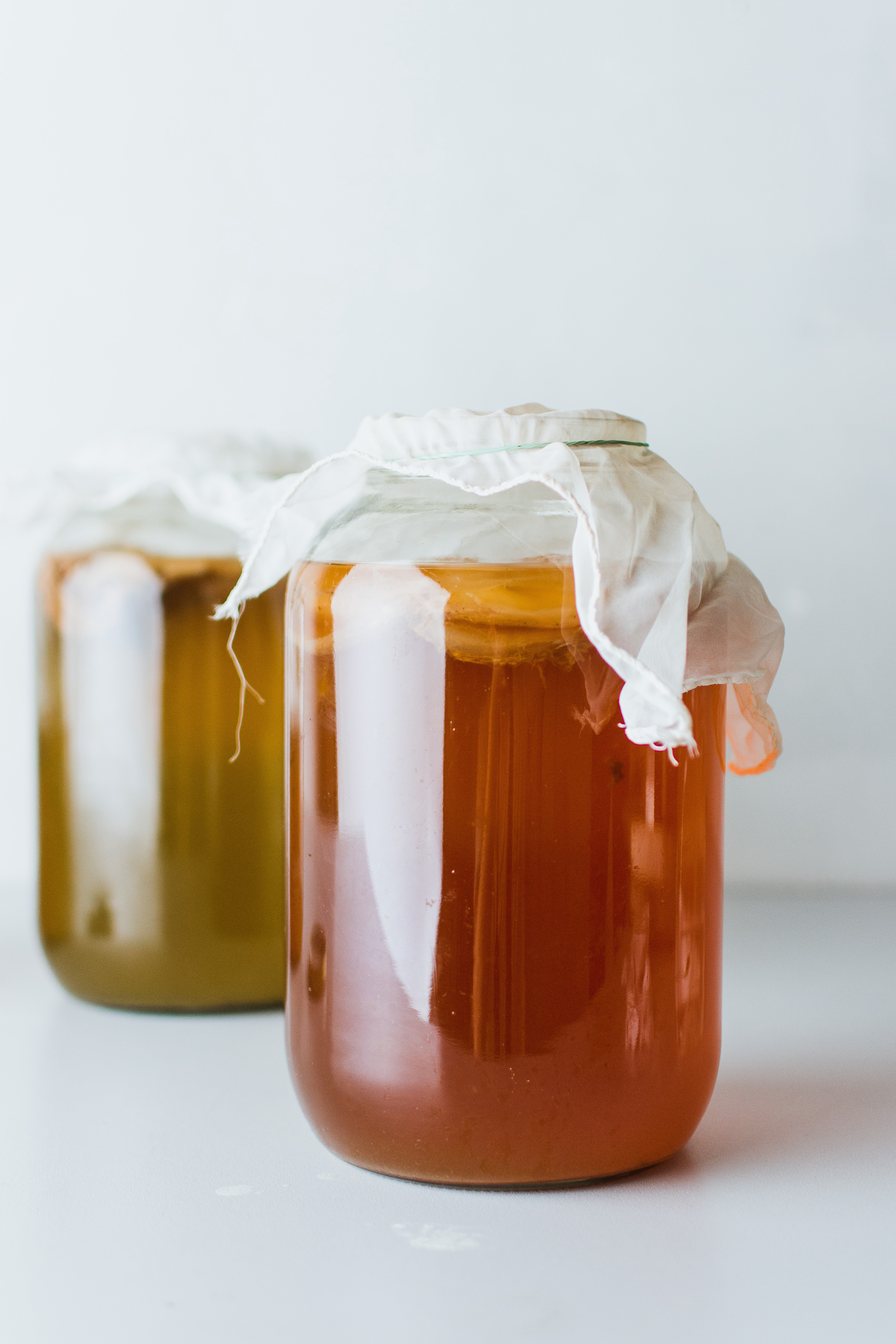 Two glass jars of fermented tea