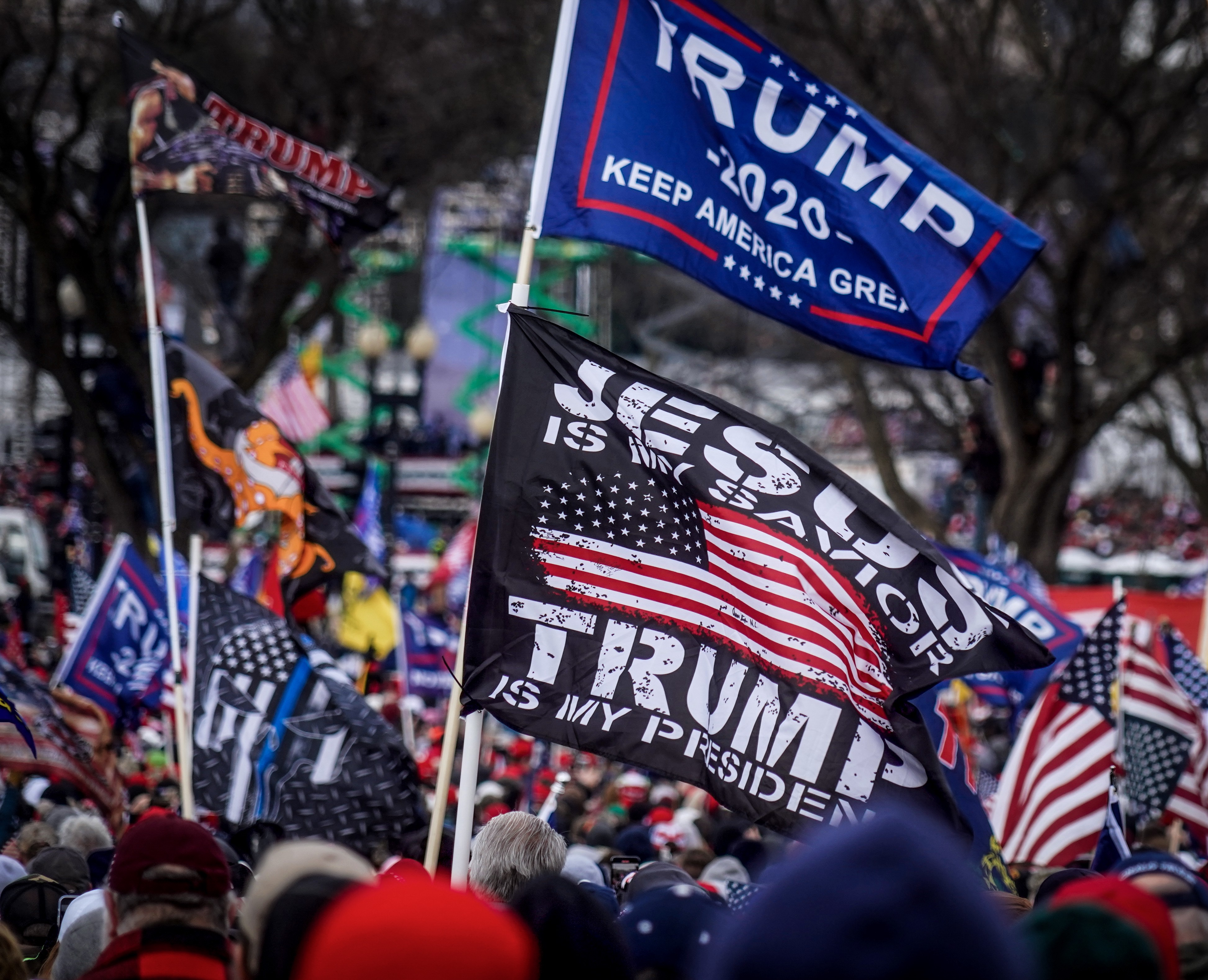Trump supporters flying flags near the U.S. Capitol following the Stop the Steal rally on January 6, 2021 in Washington, DC.