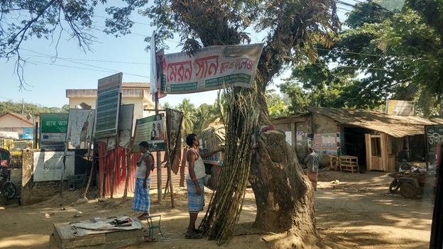 Manual laborers arranging bamboo sticks in Cox's Bazar