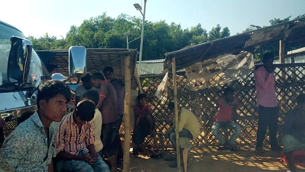 Men taking a break from work under the scorching sun at the kutupalong camp
