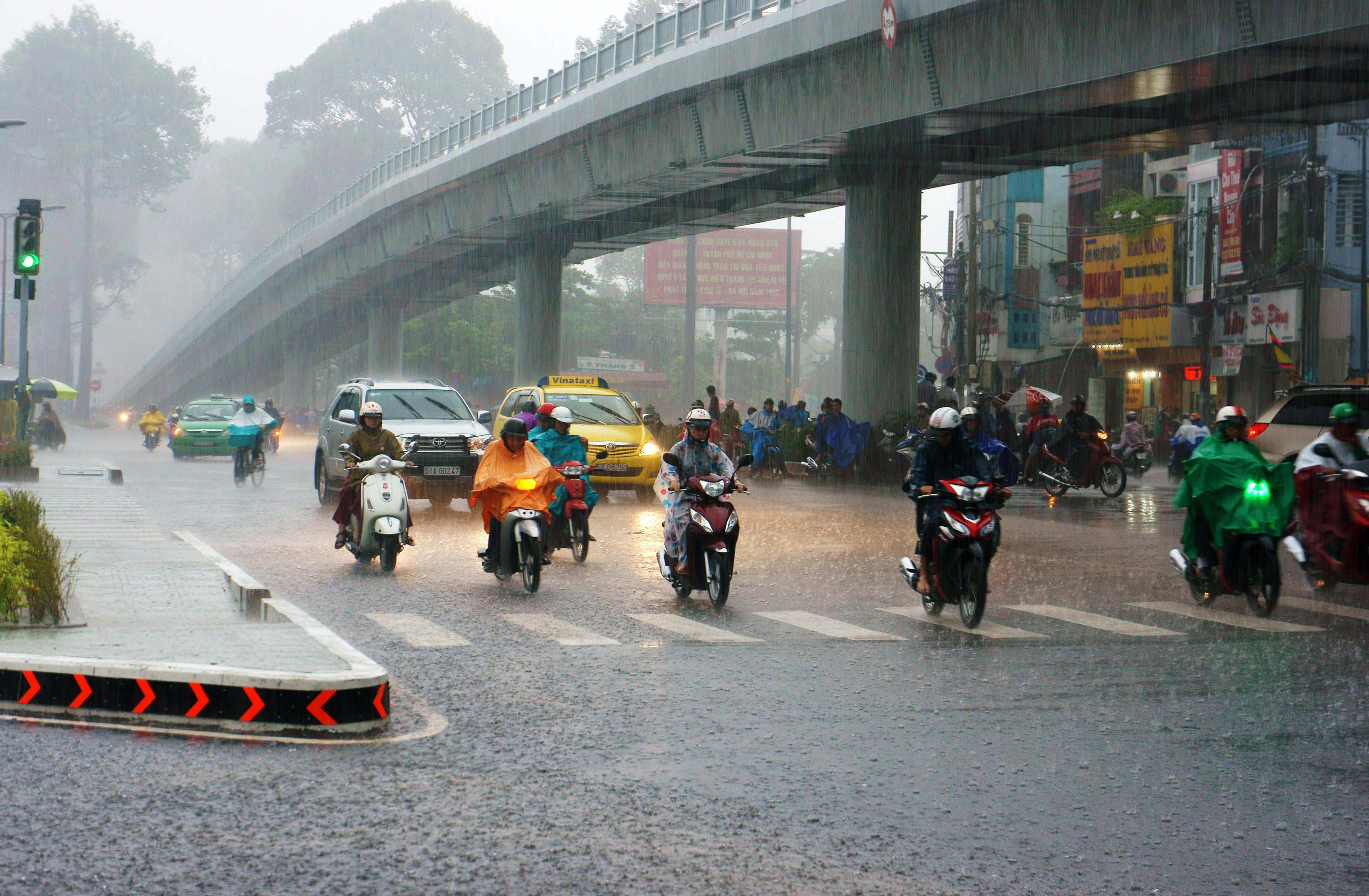 Vietnams' road with drivers in rain