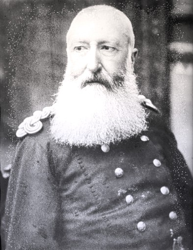 Leopold as an older man, wearing a military uniform. He has a long, snowy white beard and mustache.
