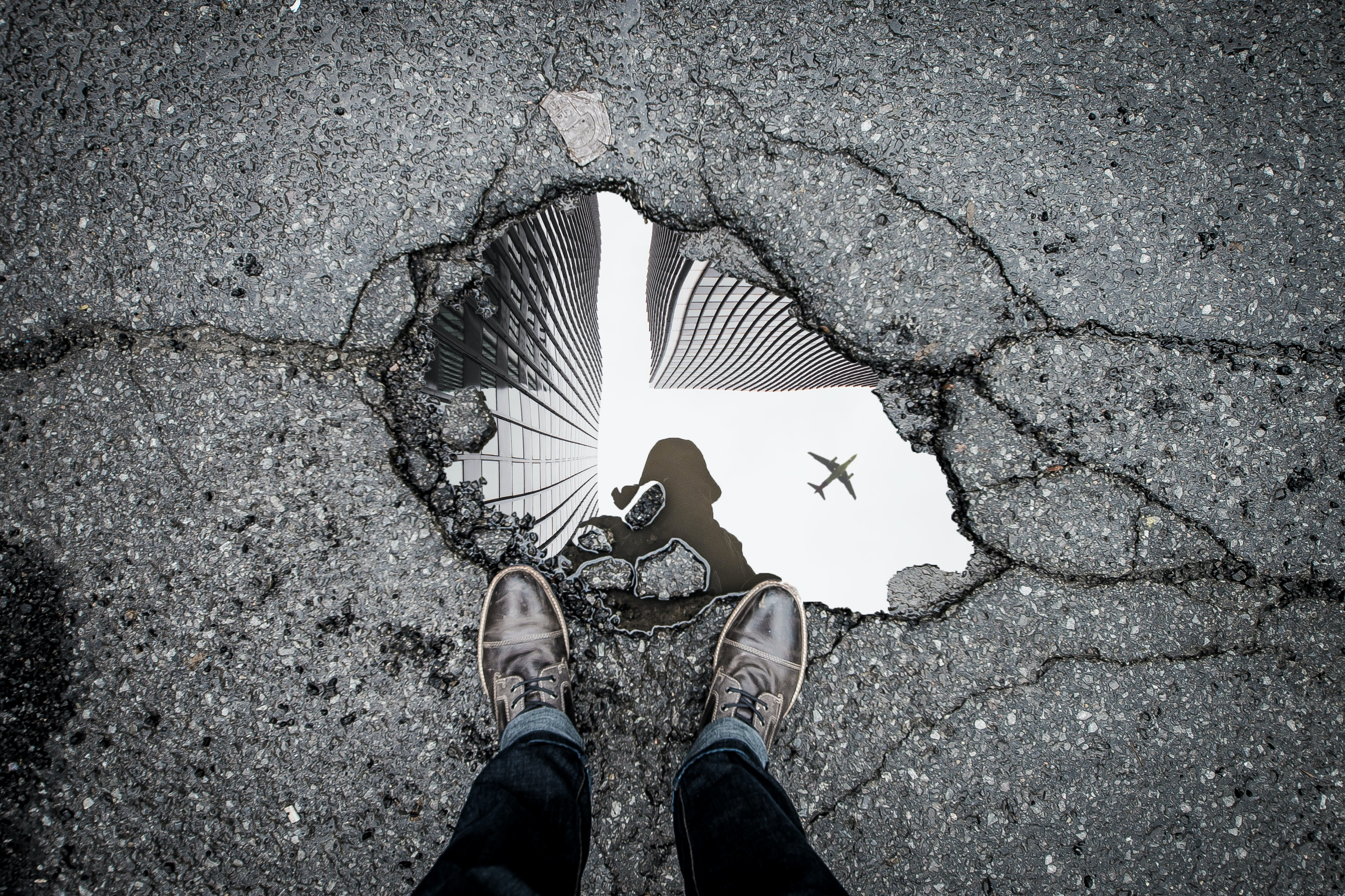 person looking down into reflection and reflecting