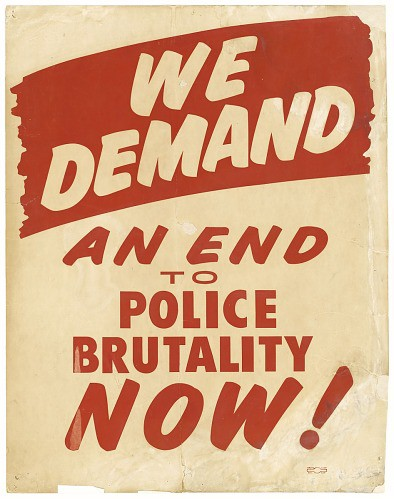 """Cardboard placard with an off-white background and red and white lettering. Overall text reads """"We demand an end to police brutality now!"""" In the upper portion of the placard is a large red swath of color with white text within that reads """"WE/ DEMAND."""" Below is red lettering in a font that mimics handwritten text that reads """"AN END/ TO/ POLICE/ BRUTALITY/ NOW!"""" All the text is centered down the middle."""