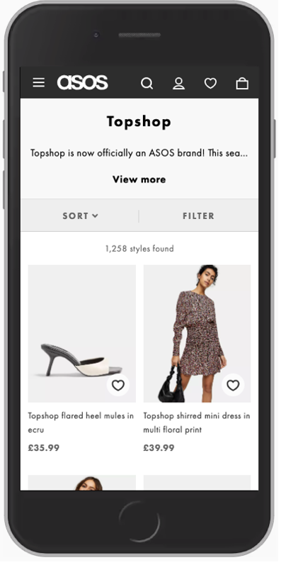 An iPhone with the ASOS website open on the Topshop PLP category page.