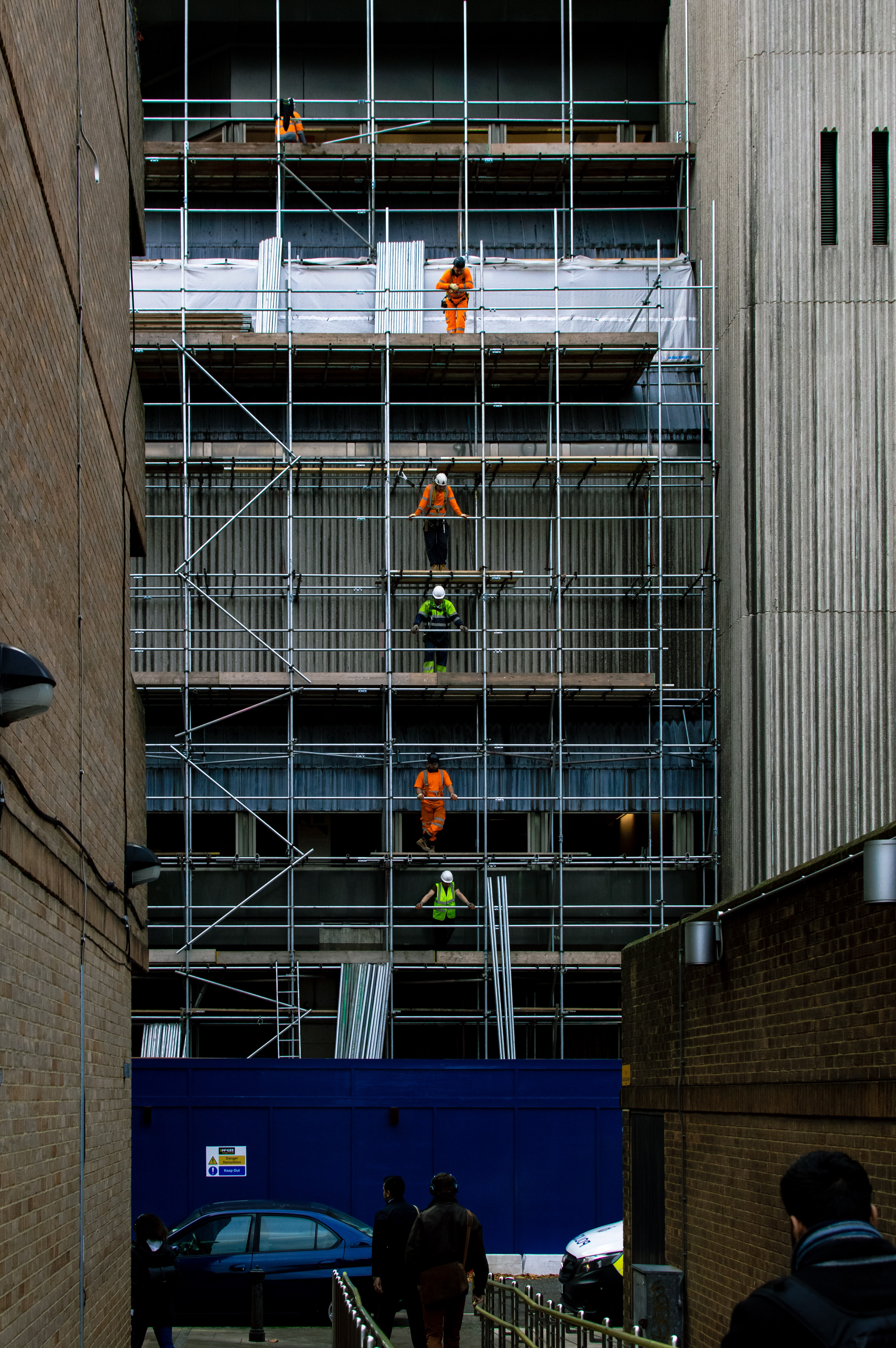 Construction workers on scaffolding.