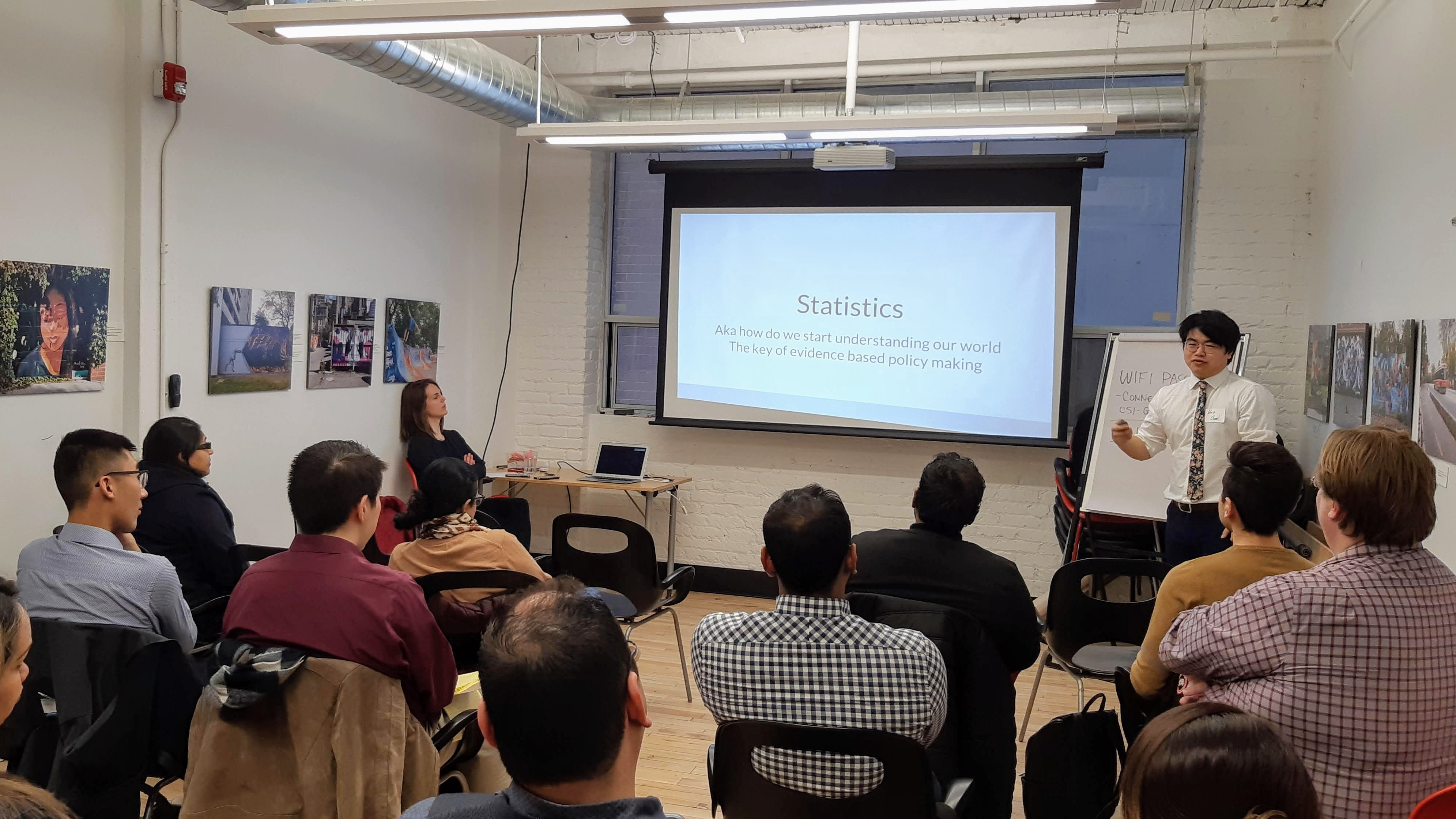Alex Chen speaking at our Data 101 coffee hour in March.