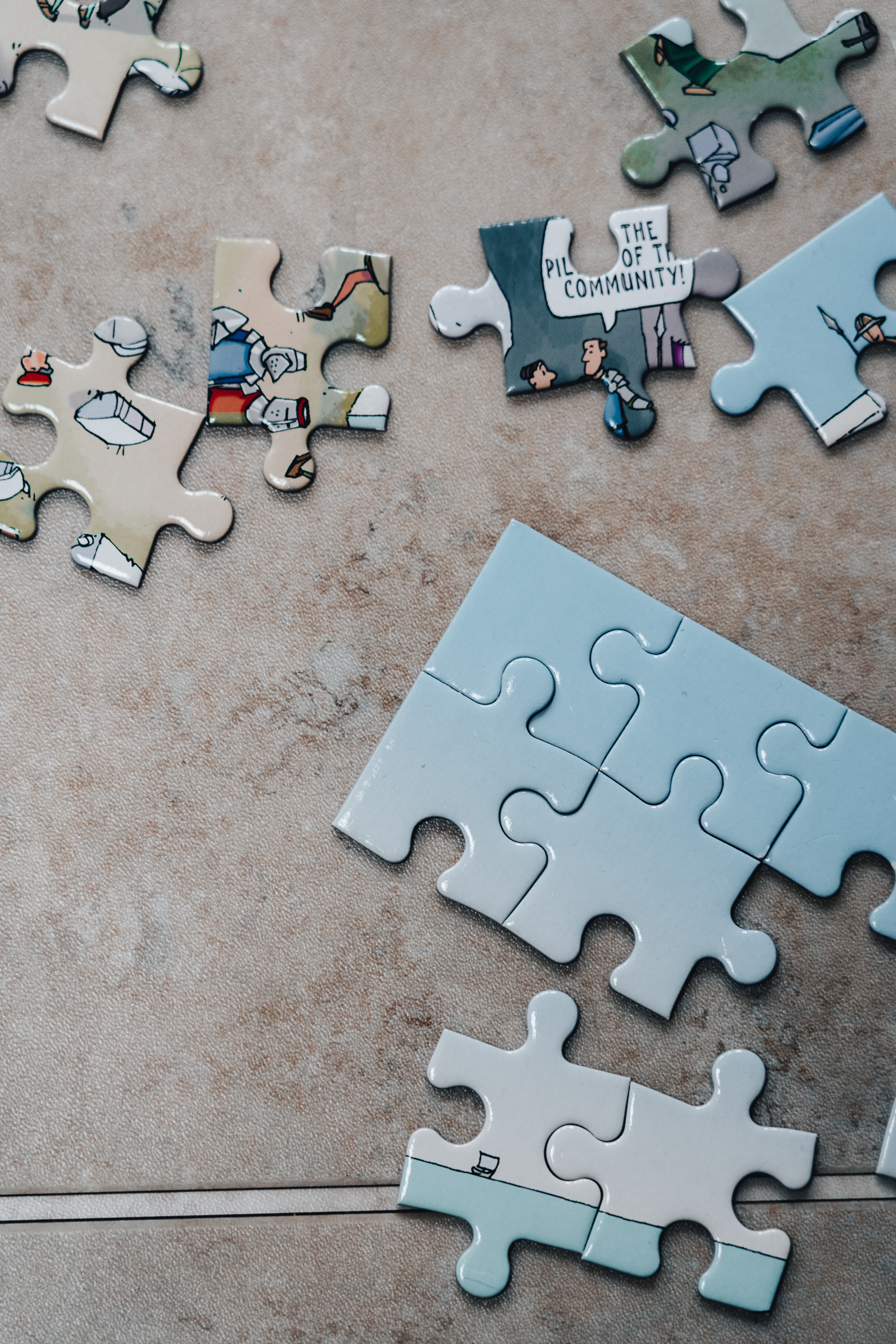 A picture of a jigsaw and various parts coming together