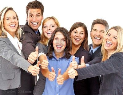 A group of (white) people giving a thumbs up in a stock photo.