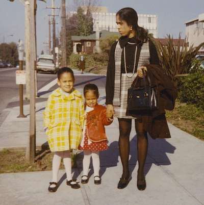 A woman with two young children